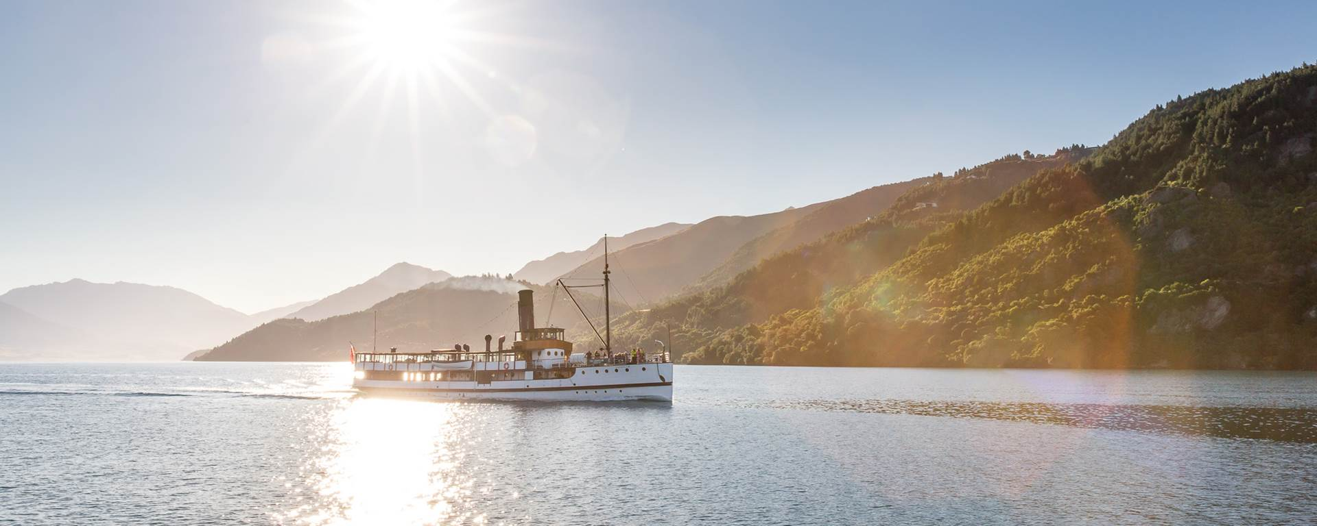 The Earnslaw cruises across Lake Wakatipu in the sunshine