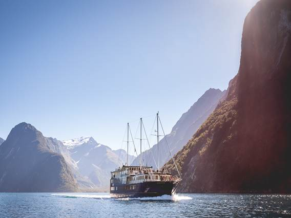 Boat cruising on Milford Sound