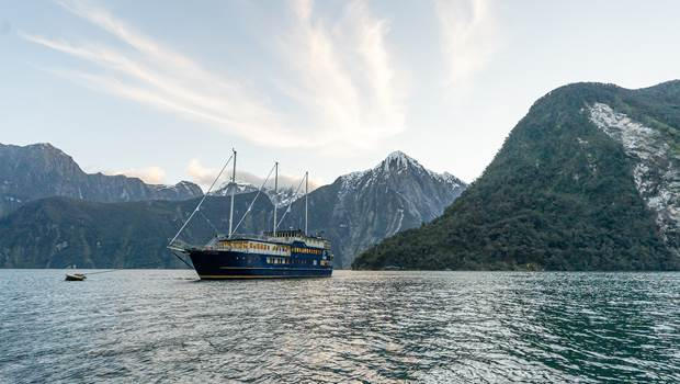 Boat moored in Milford Sound for the night